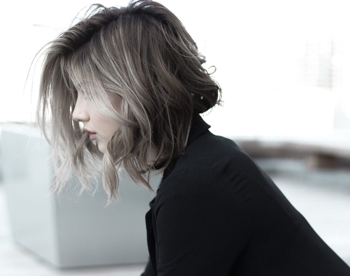 ash grey hair color with highlights wavy bob hairstyle girl with fair skin