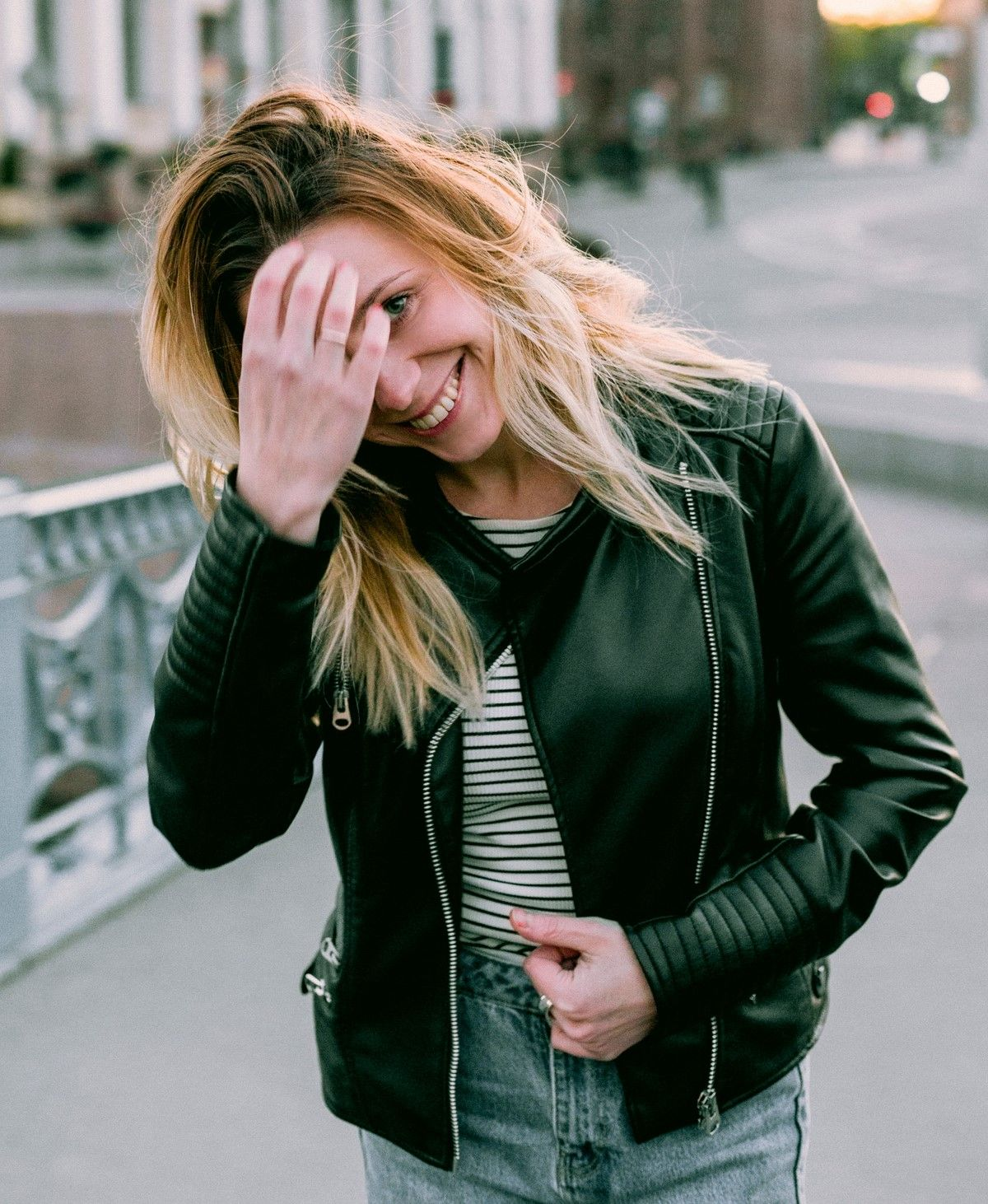 black and white striped shirt outfit ideas with grey jeans and black leather jacket