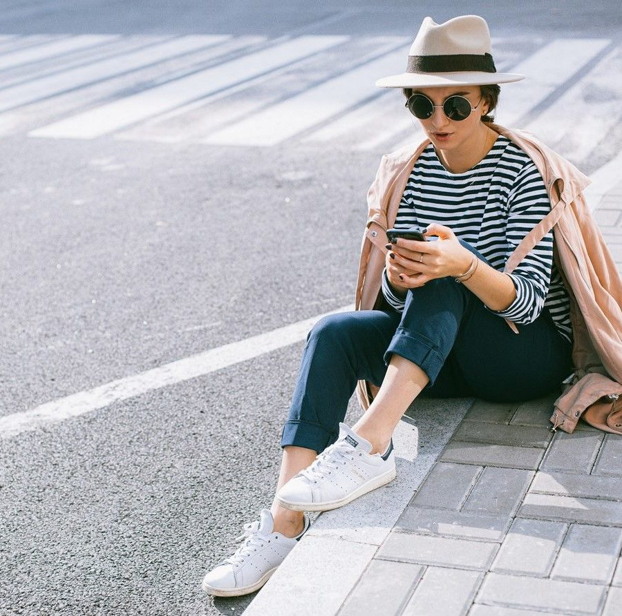 striped shirt casual outfit with white sneakers and blue trousers