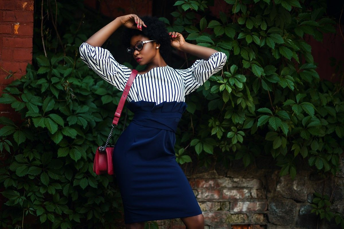 vertical striped blouse with high waisted paperbag skirt for work