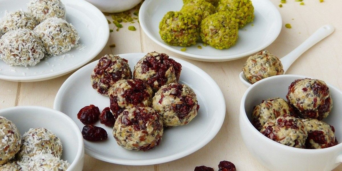 energy balls with different ingredients cranberries coconut oats pistachios flaxseed
