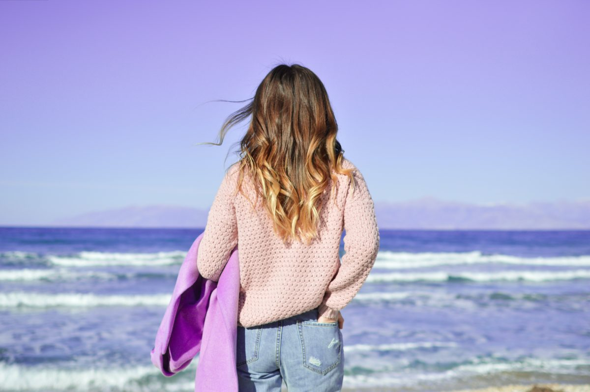beige sweater and blue denim go well with light purple jacket