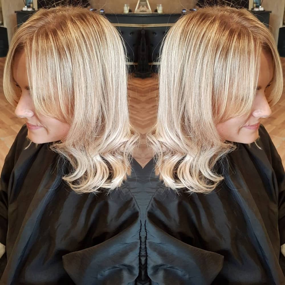 blonde hair grown out fringe and waves